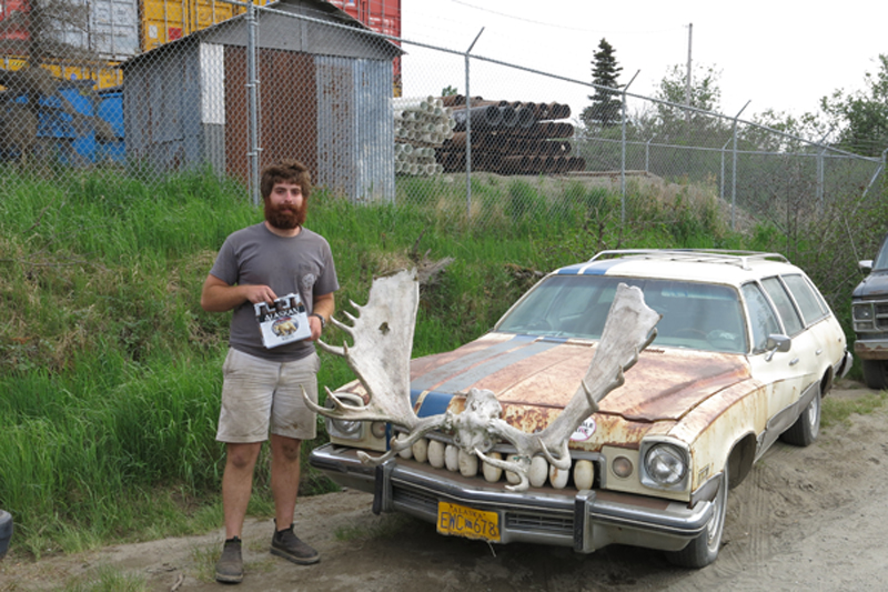 Here is the other crew member Jeff posing next to another style of typical vehicle found on the road in Naknek, Alaska.  Wild.
