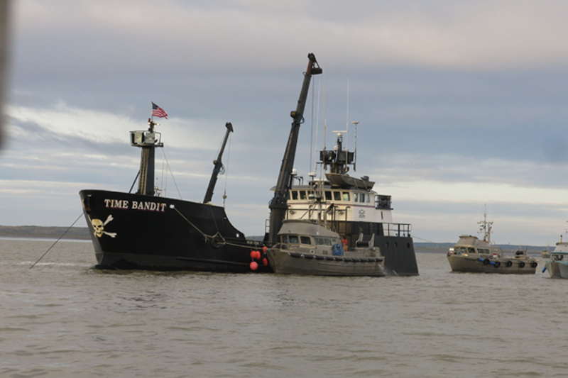 "Here is a boat off-loading its catch at the end of the day to the Trident Seafoods tender vessel ""Time Bandit"" which was featured on the Discovery TV series ""Deadliest Catch""."
