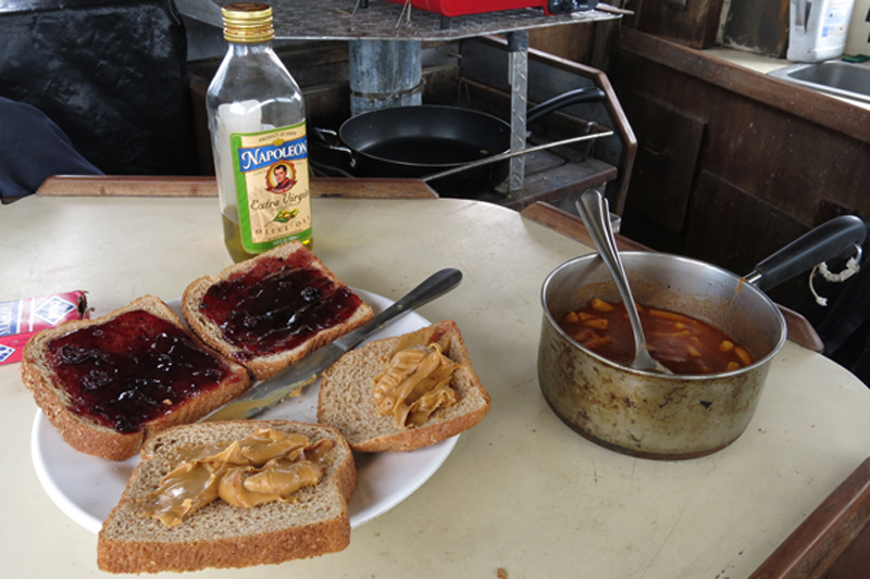 Here is Jeff's lunch, two peanut butter and jelly sandwiches and a can of chef boyardee.