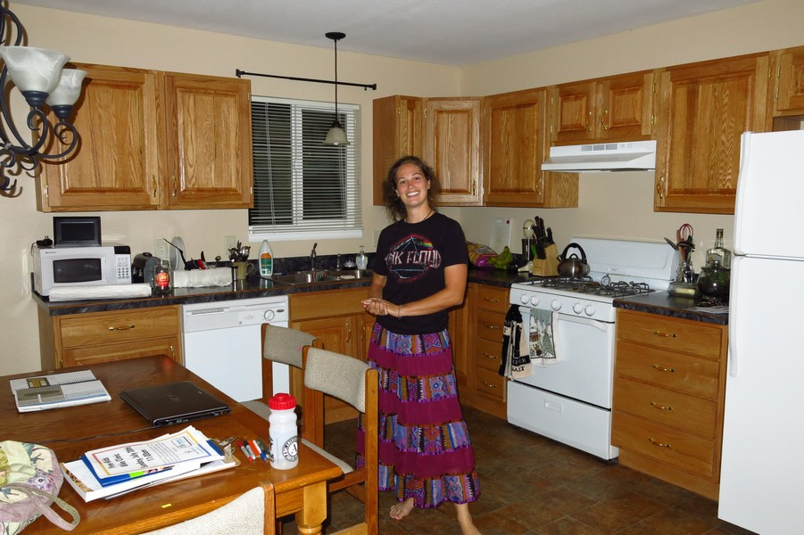 Adrienne in our new kitchen.  It's hard to believe we've only been here 2 days from the photos.  2 days in and we had it fully furnished.