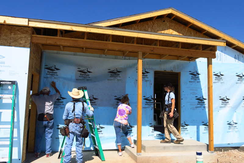 Starting the blue board and house wrap with the home owner and some volunteers during the first week.  Windows had been installed but we removed them to install the materials in the correct order.