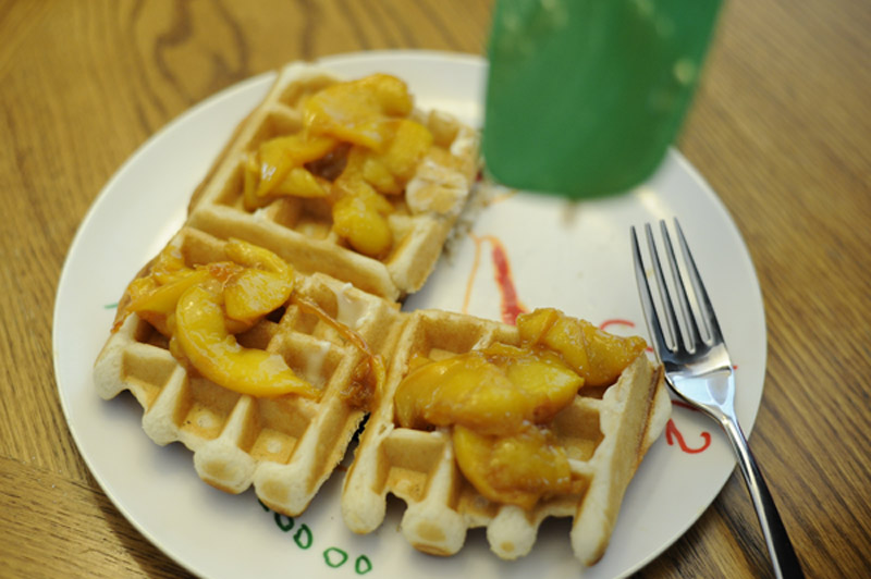 Candied Colorado peaches atop fresh waffles.