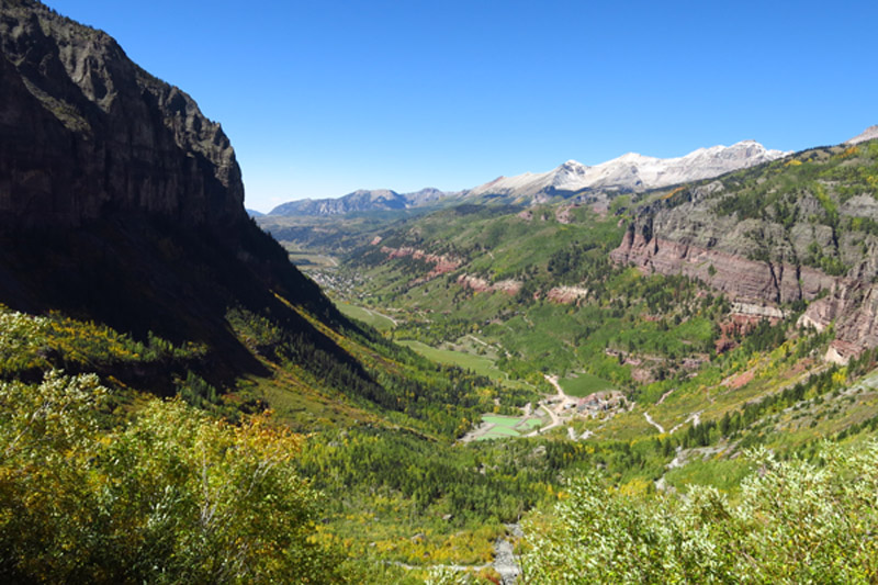 The view of the town of Telluride from the top of the falls (The Job Site).