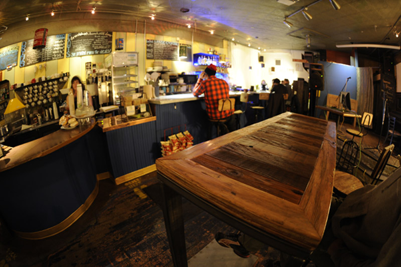 The new salvage wood topped table in the middle of the freshly remodeled shop.