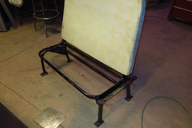 7 bus seats needed legs fabricated to make them free standing to be used as seating inside the coffee shop.