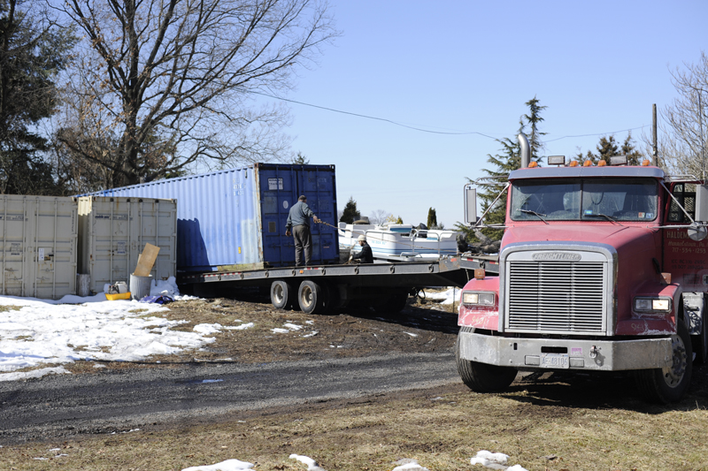 Loading the container for its journey to its new home.