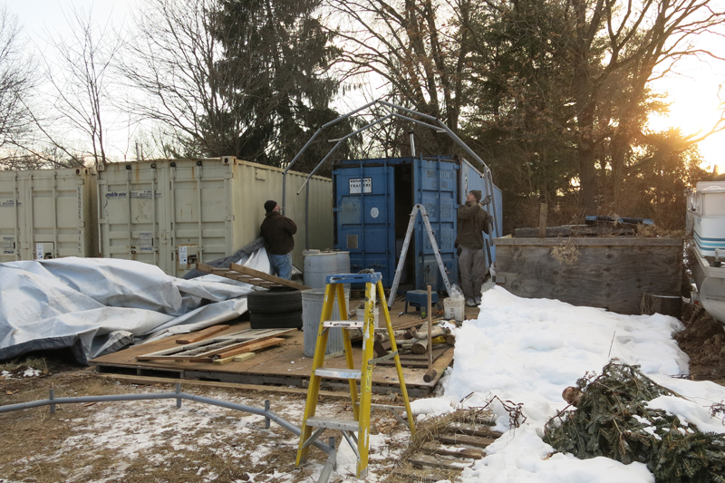 We gave the shelter to a friend of Chucks as a thank you for his help.  Here they are taking it down and hauling it off.