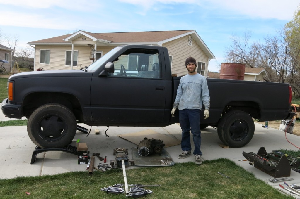 Installing the new transfer case in our driveway in Montrose.
