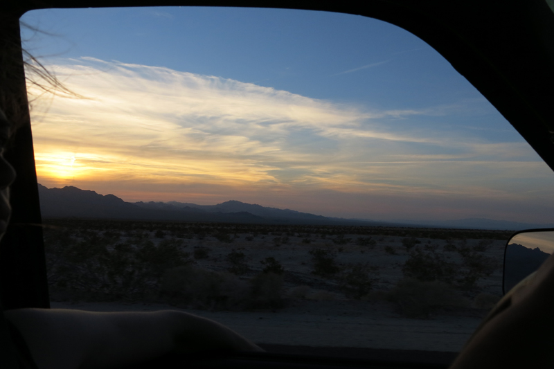 The sun setting over the mountains as we near Joshua Tree National Park.