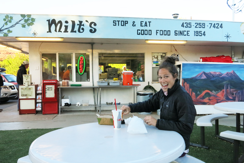 Eating a delicious burger, fries, and a milkshake at Milts in Moab, Utah.