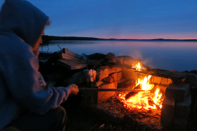 Enjoying a fire by the lake.