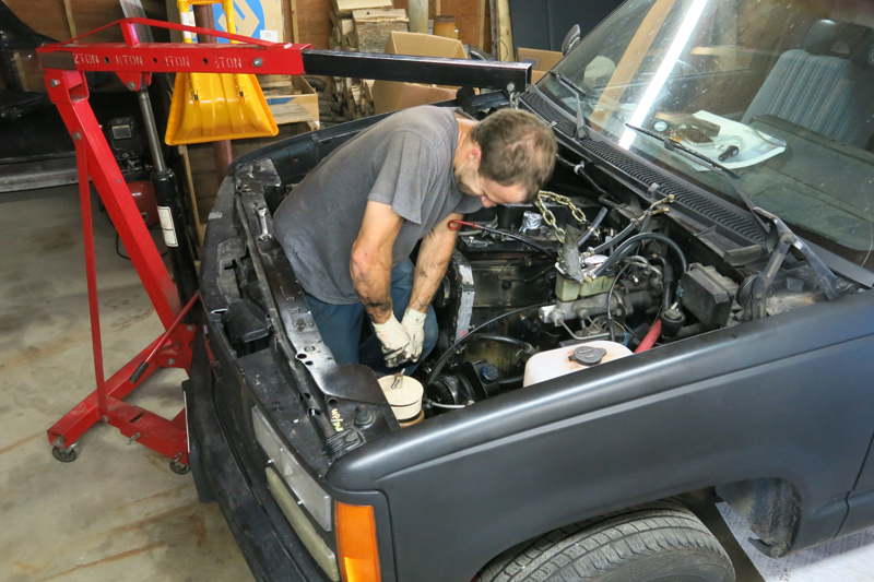 Trying to get the engine mounts loose.  It proved to be a pretty difficult task.